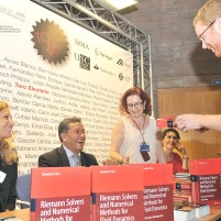 Professor Toro signs copies his book donated by Springer to PhD students