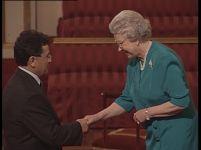 Professor Toro speaks with Queen Elizabeth about his academic work