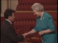 Professor Toro speaks with Queen Elizabeth about his academic work